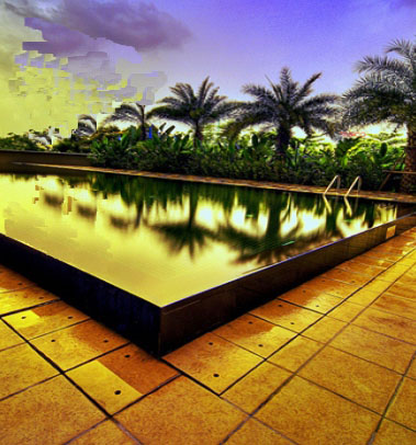 Miami Sunset over a pool - low voltage lighting to promote visual blending